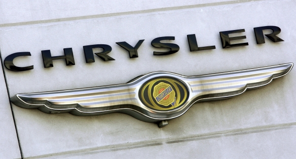 File photograph of a Chrysler logo atop a New York City car dealership
